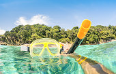 Adventurous guy taking photo of snorkeling mask underwater - Adventure travel lifestyle enjoying happy fun moment at Similan Islands beach - Trip around world nature wonders - Warm turquoise filter