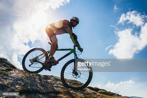 Adventurous Man riding his bike on steep terrain