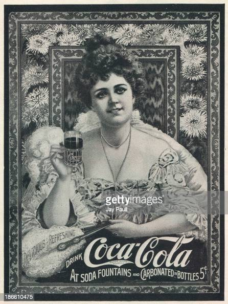 Advertisement for CocaCola picturing a lady holding a glass of Coke 1904