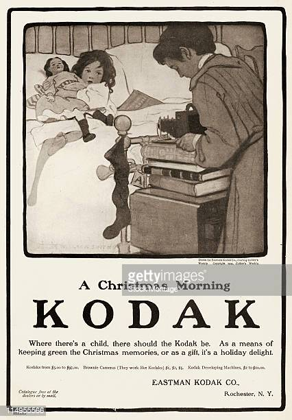 Advertisement for Kodak cameras 1904 The illustration entitled 'A Christmas Morning' depicts a woman photographs a young girl who lies in bed with a...