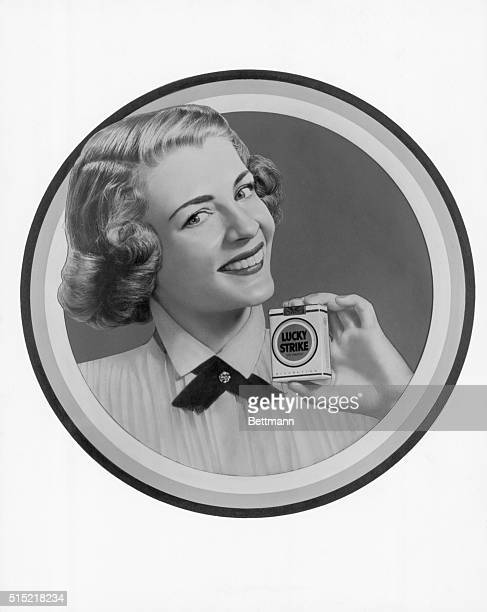 Advertisement for Lucky Strike cigarettes Woman holding a box of cigarettes and smiling Circa 1950'S Undated image