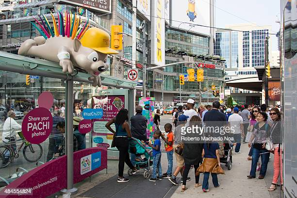SQUARE TORONTO ONTARIO CANADA Advertisement for the Toronto 2015 Pan/Parapan Am Games the children designed mascot Pachi sits on top of a public bus...