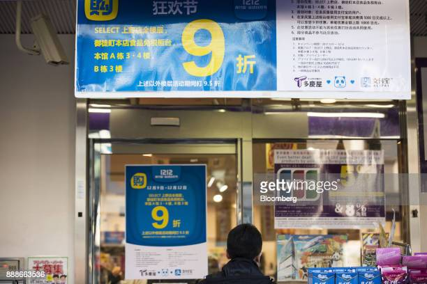 Advertisements for Ant Financial Services Group's Alipay an affiliate of Alibaba Group Holding Ltd hang above an entrance to a Takeya Co Ueno Select...