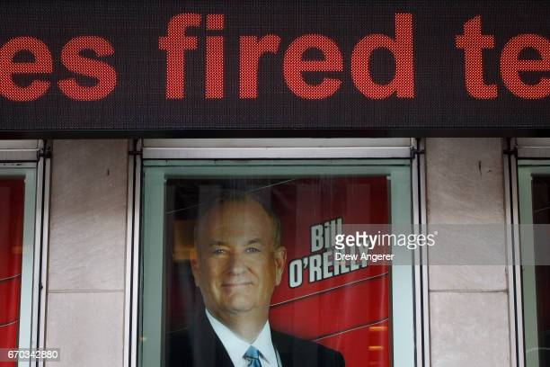 Advertisements for Fox News and Bill O'Reilly stand in a window outside of the News Corp and Fox News headquarters in Midtown Manhattan April 19 2017...