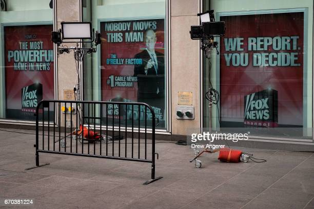 Advertisements for Fox News and Bill O'Reilly stand in the windows outside of the News Corp and Fox News headquarters in Midtown Manhattan April 19...