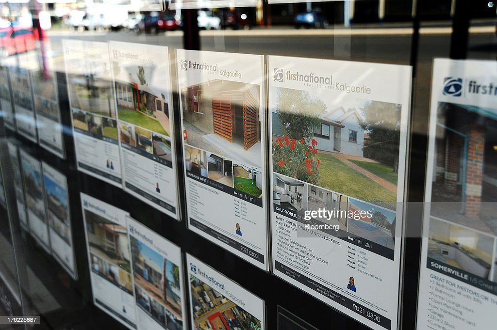 Advertisements for residential properties are displayed in the window of First National Real Estate agency's offices in the mining town of Kalgoorlie, Australia, on Thursday, Aug. 8, 2013. Western Australia, the nation's largest state by area with 2.6 million square kilometers (1 million square miles) of land, earned A$97 billion from minerals and energy sales in 2012, down from A$108 billion in 2011, according to government figures. Photographer: Carla Gottgens/Bloomberg via Getty Images