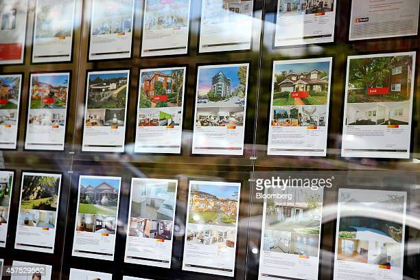 Advertisements for residential properties are displayed in the window of an LJ Hooker Ltd real estate agency in the suburb of Roseville Sydney...