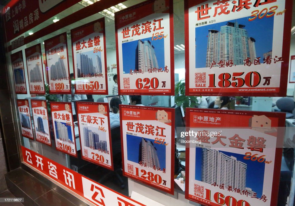 Advertisements for residential properties for sale are displayed in the window of a real estate agent's office in Shanghai, China, on Monday, July 1, 2013. China's President Xi Jinping said officials shouldn't be judged solely on their record in boosting gross domestic product, the latest signal that policy makers are prepared to tolerate slower economic expansion. Photographer: Tomohiro Ohsumi/Bloomberg via Getty Images