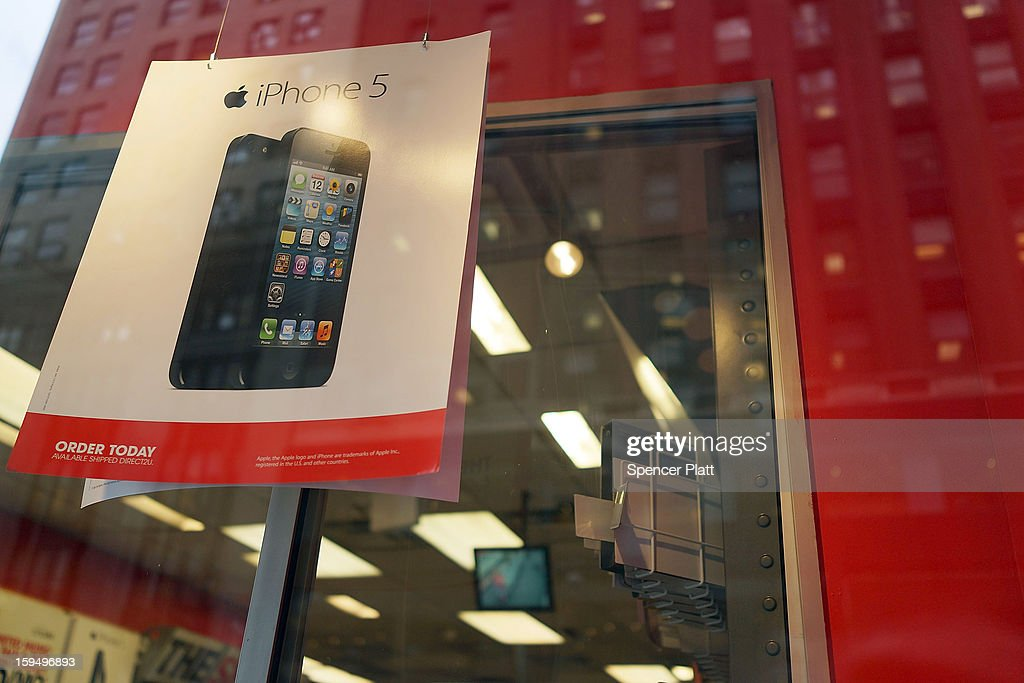 Advertisements for the iPhone 5 are displayed at a mobile phone store on January 14, 2013 in New York City. Responding to weaker than expected demand, Apple has cut orders for LCD screens and other parts for the iPhone 5 this quarter. Shares for the tech company fell more than 4 percent to $498.20 before the bell on Monday. Analysts see the slowing sales as evidence that the U.S. firm is losing ground to Asian smartphone rivals.