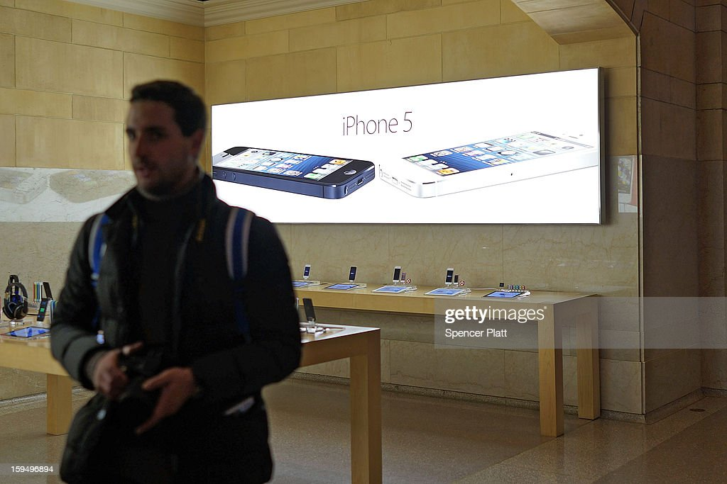 Advertisements for the iPhone 5 are displayed at an Apple store on January 14, 2013 in New York City. Responding to weaker than expected demand, Apple has cut orders for LCD screens and other parts for the iPhone 5 this quarter. Shares for the tech company fell more than 4 percent to $498.20 before the bell on Monday. Analysts see the slowing sales as evidence that the U.S. firm is losing ground to Asian smartphone rivals.