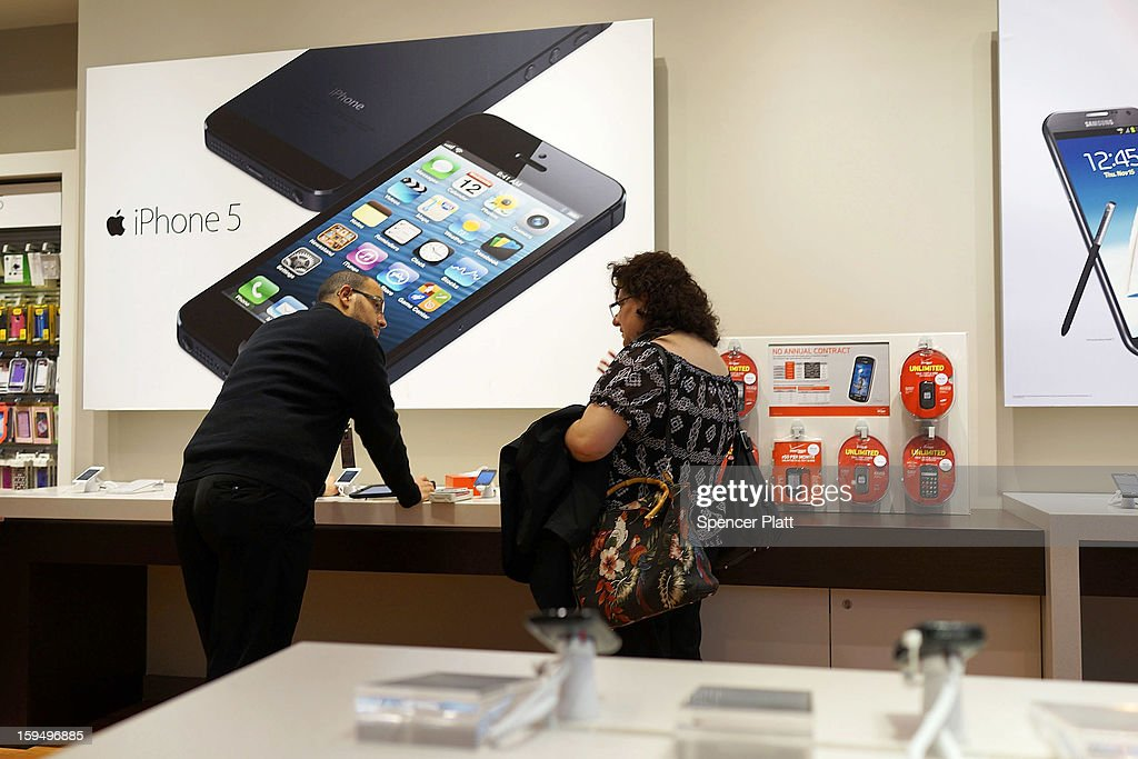Advertisements for the iPhone 5 are displayed at an mobile phone store on January 14, 2013 in New York City. Responding to weaker than expected demand, Apple has cut orders for LCD screens and other parts for the iPhone 5 this quarter. Shares for the tech company fell more than 4 percent to $498.20 before the bell on Monday. Analysts see the slowing sales as evidence that the U.S. firm is losing ground to Asian smartphone rivals.