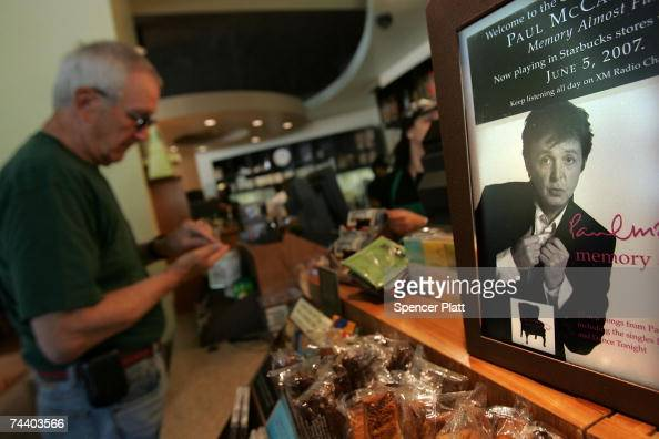Advertisements for the new Paul McCartney album 'Memory Almost Full' are displayed at a Starbucks store June 5 2007 in New York City The coffee...
