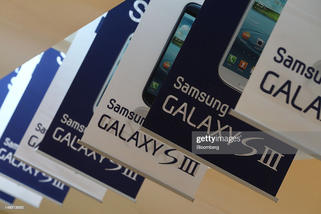 Advertisements for the Samsung Electronics Co. Galaxy S III smartphone are displayed at the company's Seocho offices in Seoul, South Korea, on Thursday, July 26, 2012. Samsung, the world's largest maker of TVs and mobile phones, reported second-quarter profit that missed analysts' estimates after chip prices weakened and smartphone output failed to keep up with demand. Photographer: SeongJoon Cho/Bloomberg via Getty Images