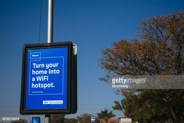 Advertising for mobile phone deals from Telkom SA SOC Ltd sit on lamp posts in Pretoria South Africa on Tuesday July 25 2017 South Africa is...