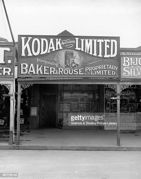 Advertising hoarding outside a Kodak shop front c 1910s