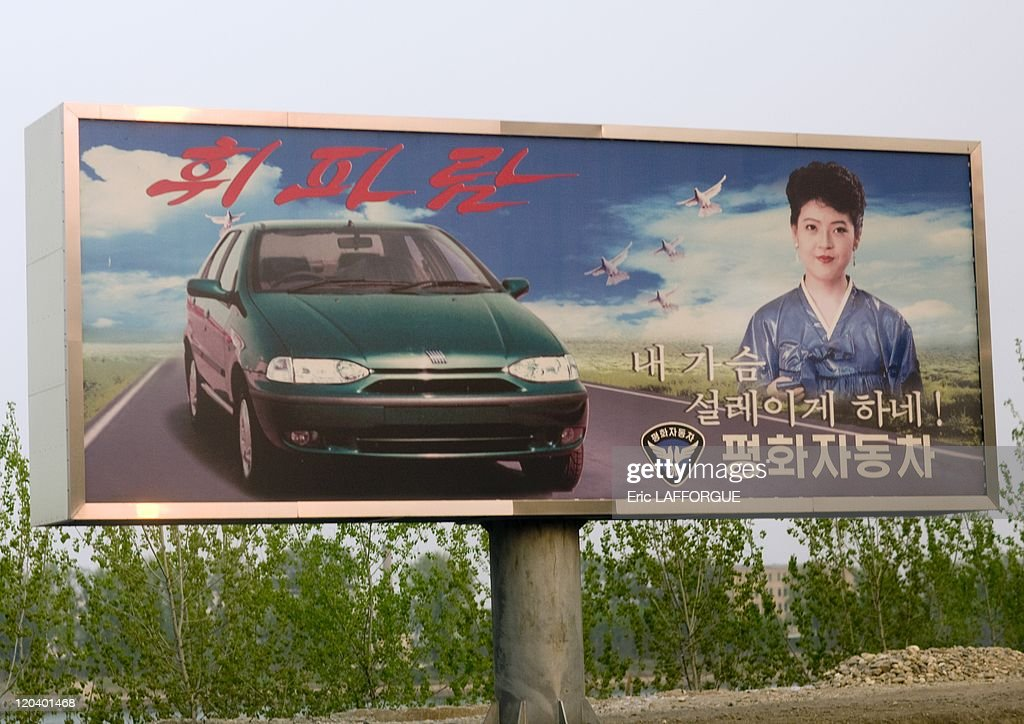 Advertising Pannel for the Peace Car in Pyongyang, North Korea - One of the very rare adverstising pannels in Pyongyang: The Peace Car. Pyeonghwa Motors (korean word for 'peace') is the sole car manufacturer and dealer in North Korea. It is a joint-venture in NampHo between Pyonghwa Motors of Seoul, a company owned by <a gi-track='captionPersonalityLinkClicked' href=/galleries/search?phrase=Sun+Myung+Moon&family=editorial&specificpeople=773635 ng-click='$event.stopPropagation()'>Sun Myung Moon</a>'s Unification Church, and the North Korean Ryonbong General Corp. The joint venture produces two small cars under licence from Fiat, and a pick-up truck and an SUV using complete knock down kits from Chinese manufacturer Dandong Shuguang.