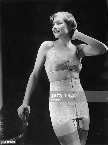 Advertising picture of a woman wearing a jacquard sateen girdle with elastic inserts on the side Photograph Around 1930