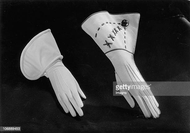 Advertising picture of two white gloves with hemmed gauntlet made of leather and cloth Photograph Around 1930