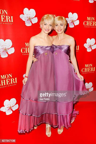 Advertising twins Julia Meise and Nina Meise attend the Mon Cheri Barbara Tag at Postpalast on December 2 2016 in Munich Germany