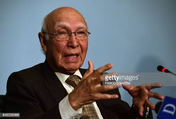 Adviser to the Pakistani Prime Minister on Foreign Affairs Sartaj Aziz gestures as he briefs media representatives at the foreign office in Islamabad...