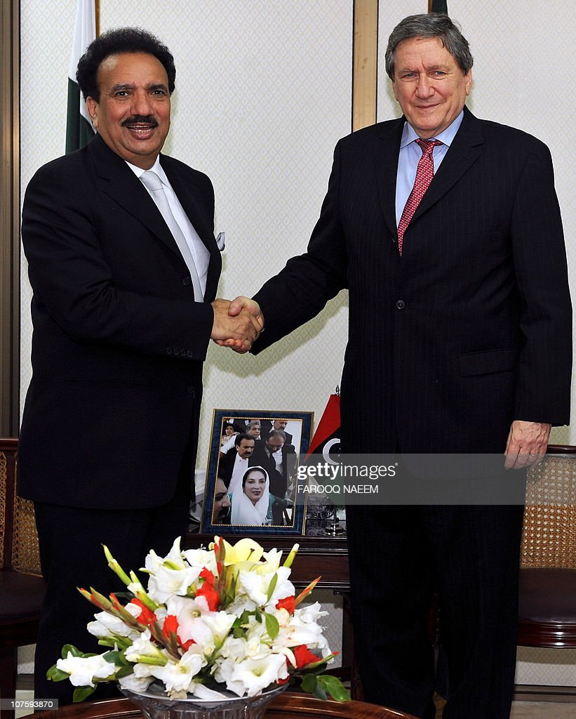 Advisor to Pakistani Prime Minister on Interior Rehman Malik shakes hands with US special envoy to Afghanistan and Pakistan Richard Holbrooke on his...