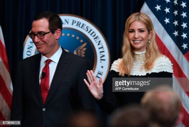 Advisor to US President Donald Trump his daughter Ivanka Trump waves beside US Treasury Secretary Steve Mnuchin following a fireside chat on tax...
