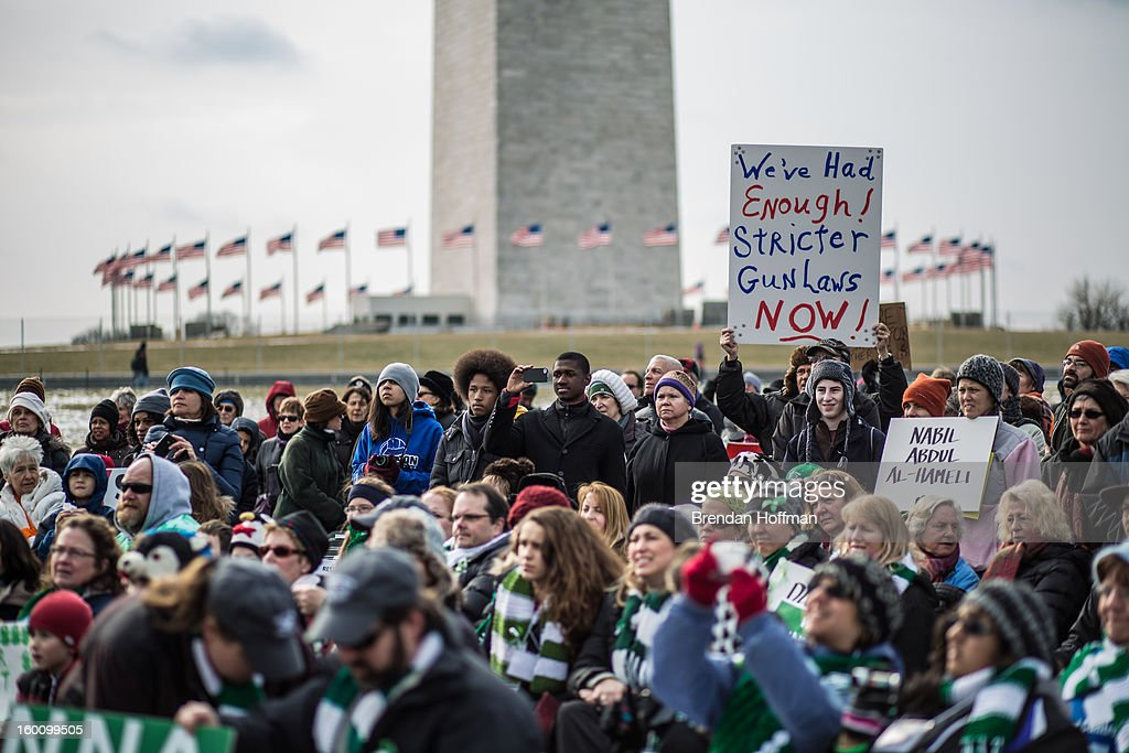 Advocates of stricter gun control laws gather on the National Mall for a rally following a march through downtown on January 26, 2013 in Washington, DC. The demonstrators included survivors of the shooting at Virginia Tech, Newtown, Connecticut, and others.