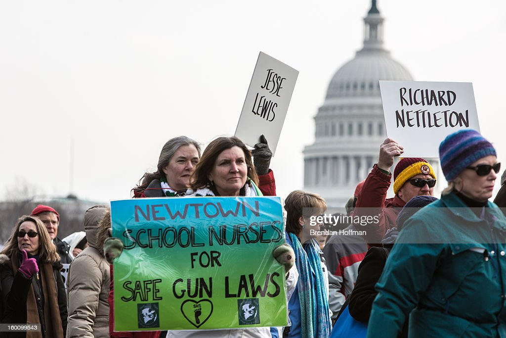 Advocates of stricter gun control laws march near the U.S. Capitol on January 26, 2013 in Washington, DC. The demonstrators included survivors of the shooting at Virginia Tech, Newtown, Connecticut, and others.