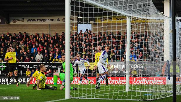 ADwight Gale of Newcastle United back heels the ball and scores the opening goal during the Sky Bet Championship match between Burton Albion and...