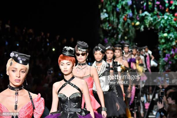 Adwoa Aboah and models walk the runway at the Moschino Ready to Wear Spring/Summer 2018 fashion show during Milan Fashion Week Spring/Summer 2018 on...
