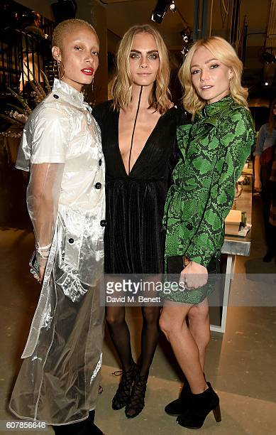 Adwoa Aboah Cara Delevingne and Clara Paget wearing Burberry at the Burberry September 2016 show during London Fashion Week SS17 at Makers House on...