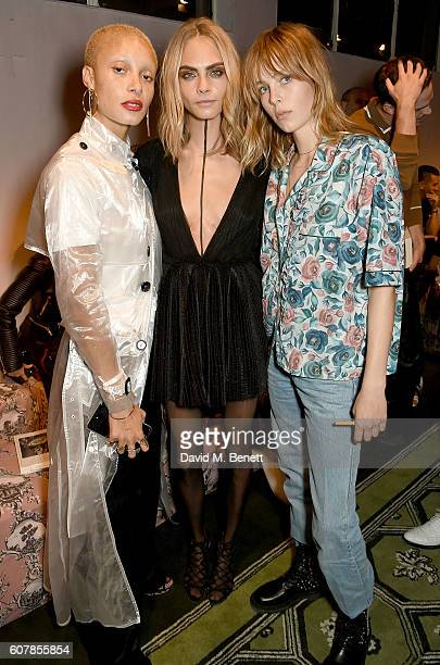 Adwoa Aboah Cara Delevingne and Edie Campbell wearing Burberry at the Burberry September 2016 show during London Fashion Week SS17 at Makers House on...