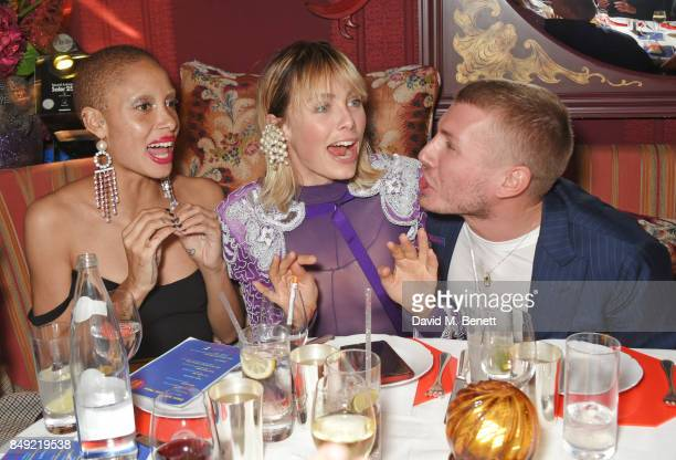 Adwoa Aboah Edie Campbell and Felix Cooper attend the LOVE magazine x Miu Miu party held during London Fashion Week at Loulou's on September 18 2017...