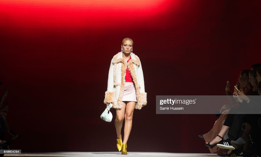 Adwoa Aboah walks the runway at the TOPSHOP show during London Fashion Week September 2017 on September 17, 2017 in London, England.