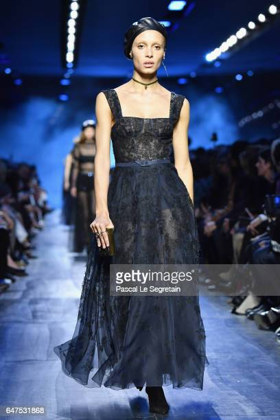 Adwoa Aboah walks the runway during the Christian Dior show as part of the Paris Fashion Week Womenswear Fall/Winter 2017/2018 at Musee Rodin on...