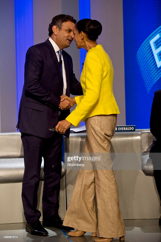 Aecio Neves, candidate from the Brazilian Social Democratic Party (PSDB), shakes hands with Marina Silva, candidate from the Brazilian Socialist Party (PSB), prior to a presidential election debate sponsored by Globo TV in Rio de Janeiro, Brazil, on Thursday, Oct. 2, 2014. Brazilian opposition candidate Marina Silva is losing support for this month's presidential election almost as fast as she once gained it, as she fails to deflect criticism from challengers that she lacks the experience and political support to lead. Photographer: Dado Galdieri/Bloomberg via Getty Images