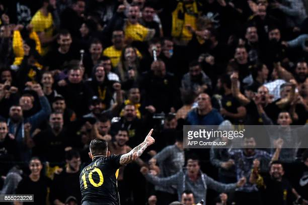 Aek's Croatian forward Marko Livaja celebrates with supporters after scoring a goal during the UEFA Europa League Group D football match between AEK...