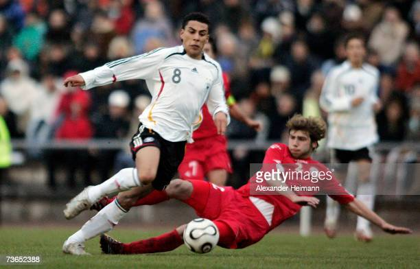 Aenis Ben Hatira of Germany competes with Gulverd Tomashvili of Georgia during the Men's U19 international friendly match between Germany and Georgia...