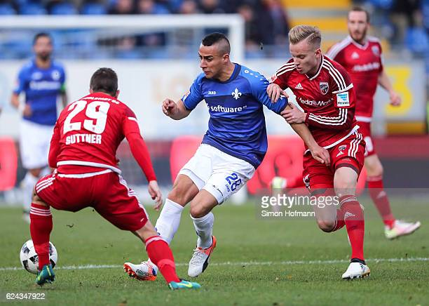 Aenis BenHatira of Darmstadt is challenged by Florent Hadergjonaj of Ingolstadt during the Bundesliga match between SV Darmstadt 98 and FC Ingolstadt...