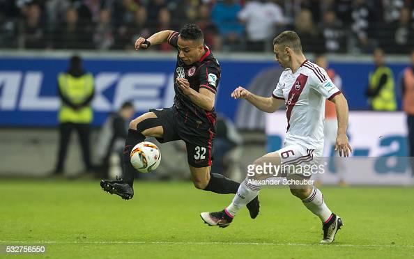 Aenis BenHatira of Eintracht Frankfurt challenges Laszlo Sepsi of Nuernberg during the bundesliga playoff between Eintracht Frankfurt and 1 FC...
