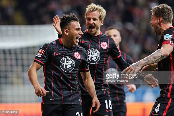Aenis BenHatira of Frankfurt celebrates his team's first goal with team mates Stefan Aigner and Marco Russ during the Bundesliga match between...