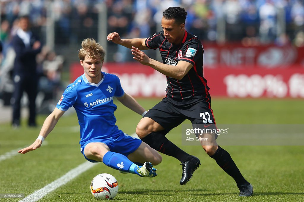 Aenis Ben-Hatira (R) of Frankfurt is challenged by Florian Jungwirth of Darmstadt during the Bundesliga match between SV Darmstadt 98 and Eintracht Frankfurt at Merck-Stadion am Boellenfalltor on April 30, 2016 in Darmstadt, Hesse.