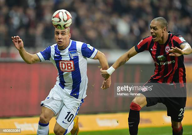 Aenis BenHatira of Hertha BSC and Anderson Soares de Oliveira of Eintracht Frankfurt duel during the Bundesliga match between Eintracht Frankfurt and...