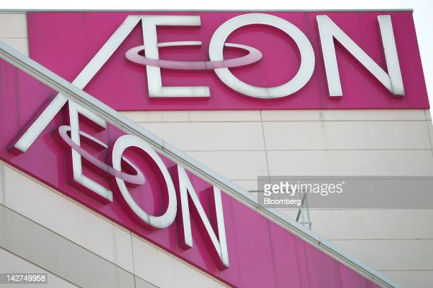 Aeon Co logos are displayed atop the company's shopping center in Tokyo Japan on Thursday April 12 2012 Aeon Co Japan's largest supermarket operator...