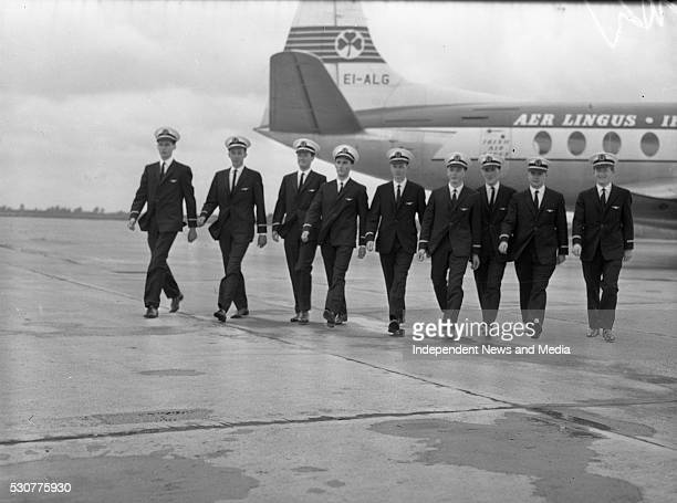 Aer Lingus pilots striding across the runway with plane behind them circa 1960