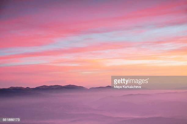 Aereal view of pink sunrise in a mountain