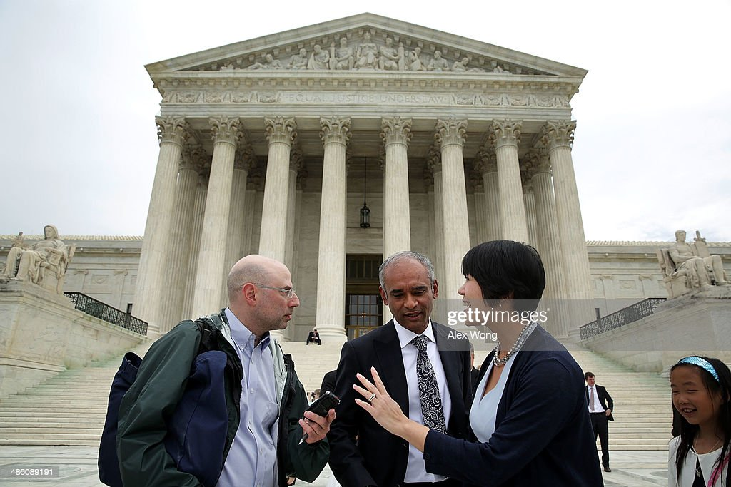 Aereo Vice President of Communications and Government Relations Virginia Lam (R) turns down a question from a member of the media (L) as Aereo CEO Chet Kanojia (2nd L) leaves the U.S. Supreme Court after oral arguments April 22, 2014 in Washington, DC. The Supreme Court heard arguments in a case against Aereo on the companys profiting from rebroadcasting network TVs programs obtained from public airwaves.
