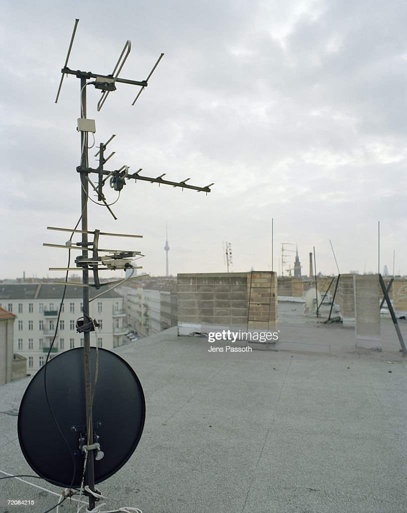 Tv Aerial And Satellite Dish On Apartment Roof Stock Photo   Getty ...