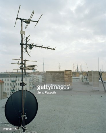 Tv Aerial And Satellite Dish On Apartment Roof Stock Photo | Getty ...