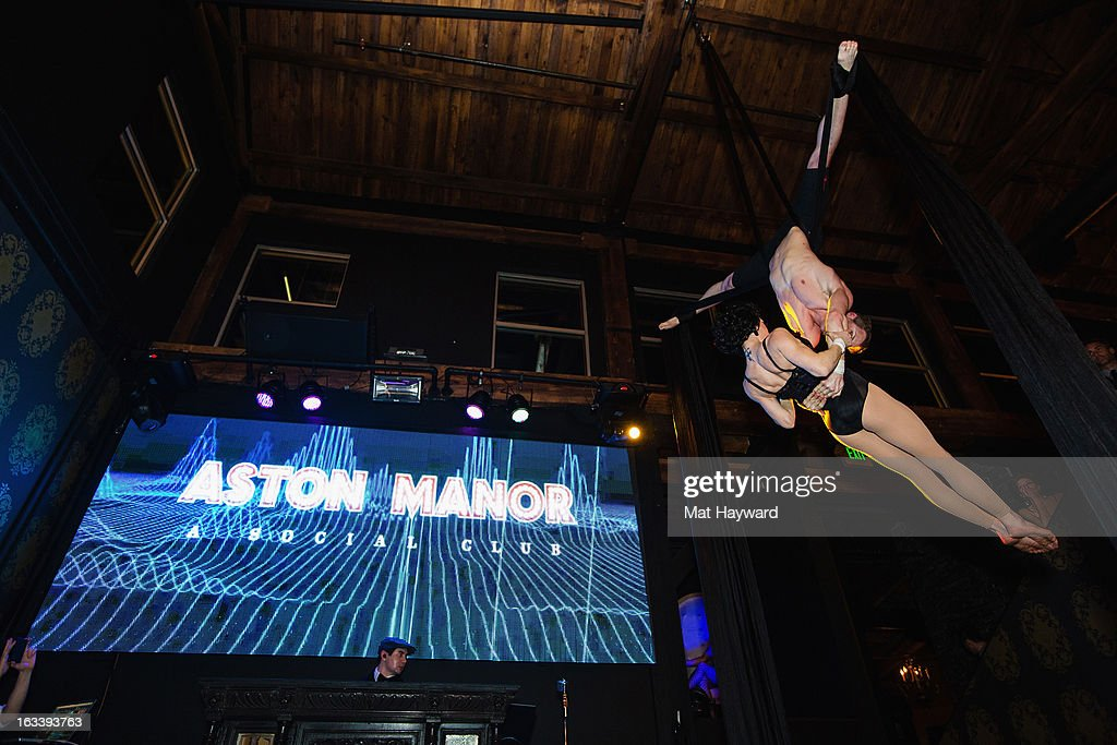 Aerial Dancers perform during the Sodo Comes Alive Party at Aston Manor on March 8, 2013 in Seattle, Washington.